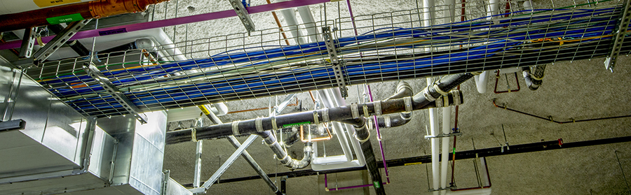 Wiring and plumbing for water, HVAC, communication and waste water in a commercial installation.